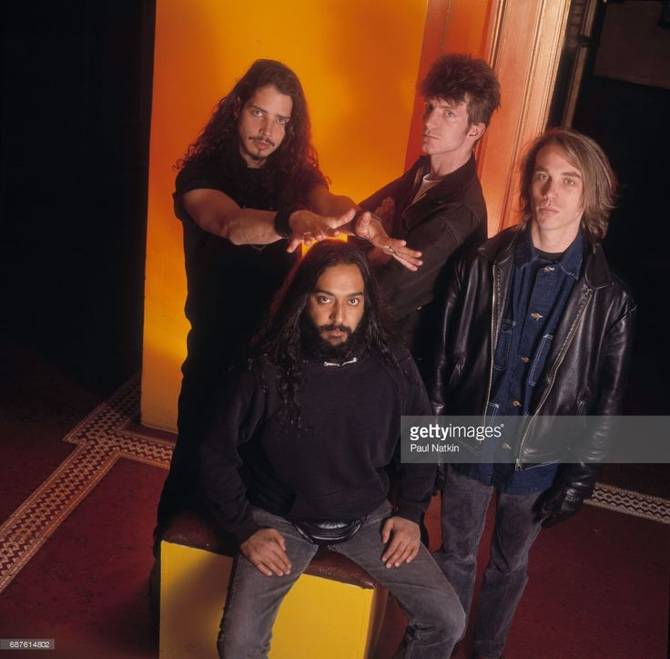 Group portrait of members of the Rock band Soundgarden as they pose at the Vic Theater, Chicago, Illinois, November 8, 1991. Pictured are, standing from left, Chris Cornell, Ben Shepherd, and Matt Cameron; seated fore, Kim Thayil.