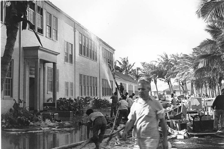 Rescue workers help evacuate the Lunalilo High School in Honolulu after the roof of the main building was hit by a bomb during the Japanese attack at Pearl Harbor, Hawaii in this Dec. 7, 1941 file photo.  (