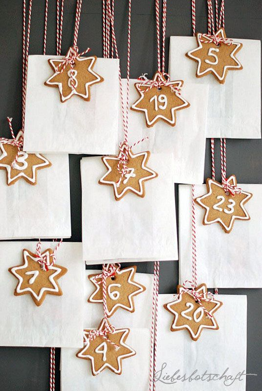 Liebesbotschaft . Advent . { love this advent calendar . super lovely but simple iced cookie tags . tied with red / white twine . perfect for a simple christmas } .