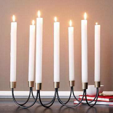 Gold + Black Candelabra is made of solid brass and holds seven tapers—perfect for topping a mid-century style table, or adding a modern, retro-inspired accent to any room.