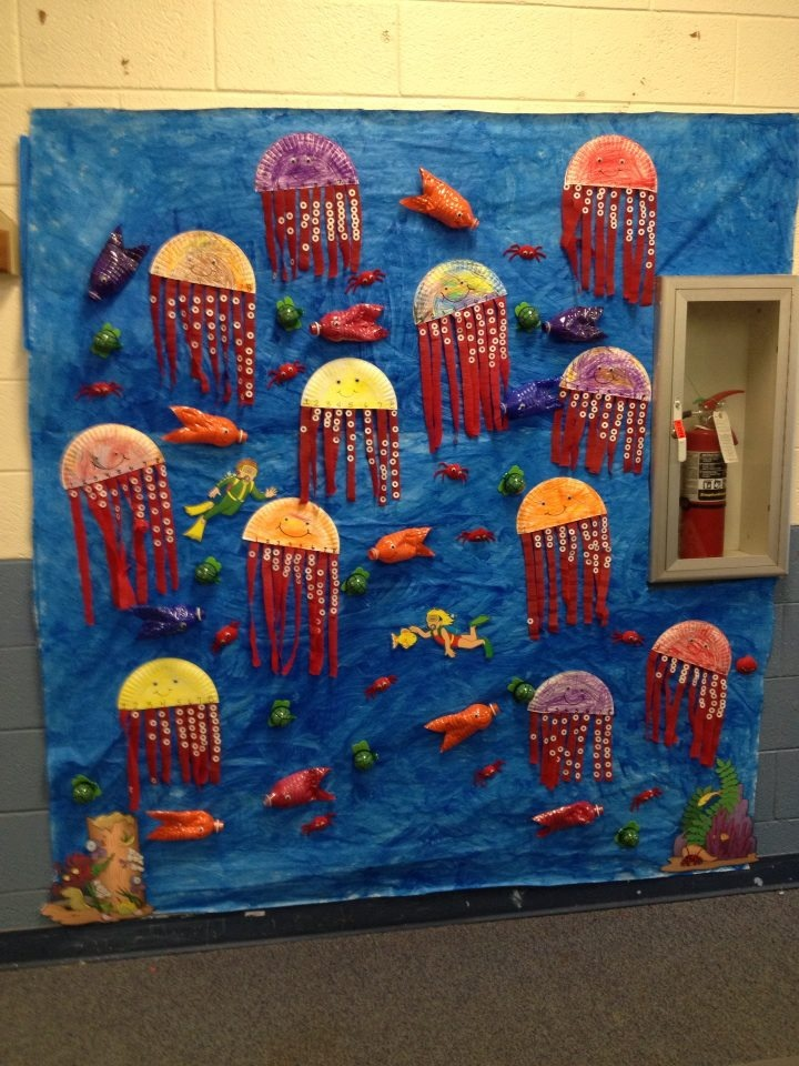 """Ocean Bulletin Board! Fish- Painted Water Bottles, Crab- Painted sea shell and pipe cleaners, Jellyfish (or Octapus) paper plate cut in half and streamers used as legs (we did a counting activity with this and the students had to put the correct amount of """"suckers"""" (Paper reinforcers) on each leg, Sea turtle- empty gum ball machine containers"""