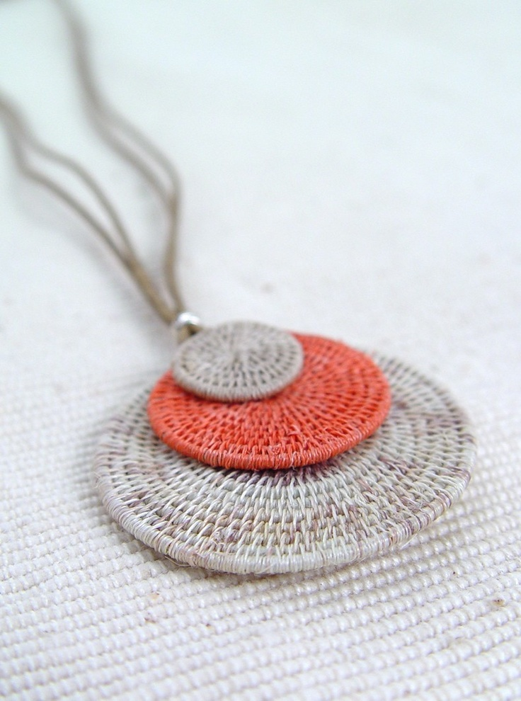 "Eclipsing Necklace with XL Disk. Handmade Sisal Necklace | Swaziland. Tintsaba was created in 1985 by Sheila Freemantle with the purpose of improving the lives of rural women in Swaziland. Length: 10""  Large Disk Diameter: 1.75""  Made In: Swaziland  Producer: Tintsaba  $39.00"