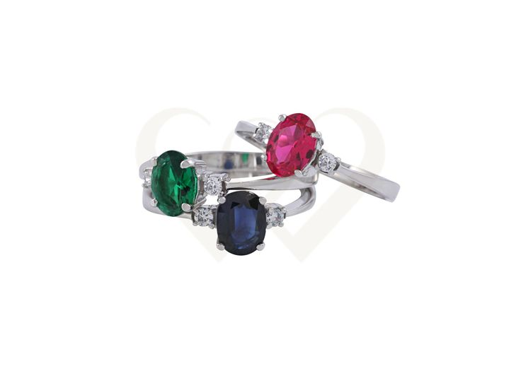 Diamond rings with ruby or emerald or sapphire.