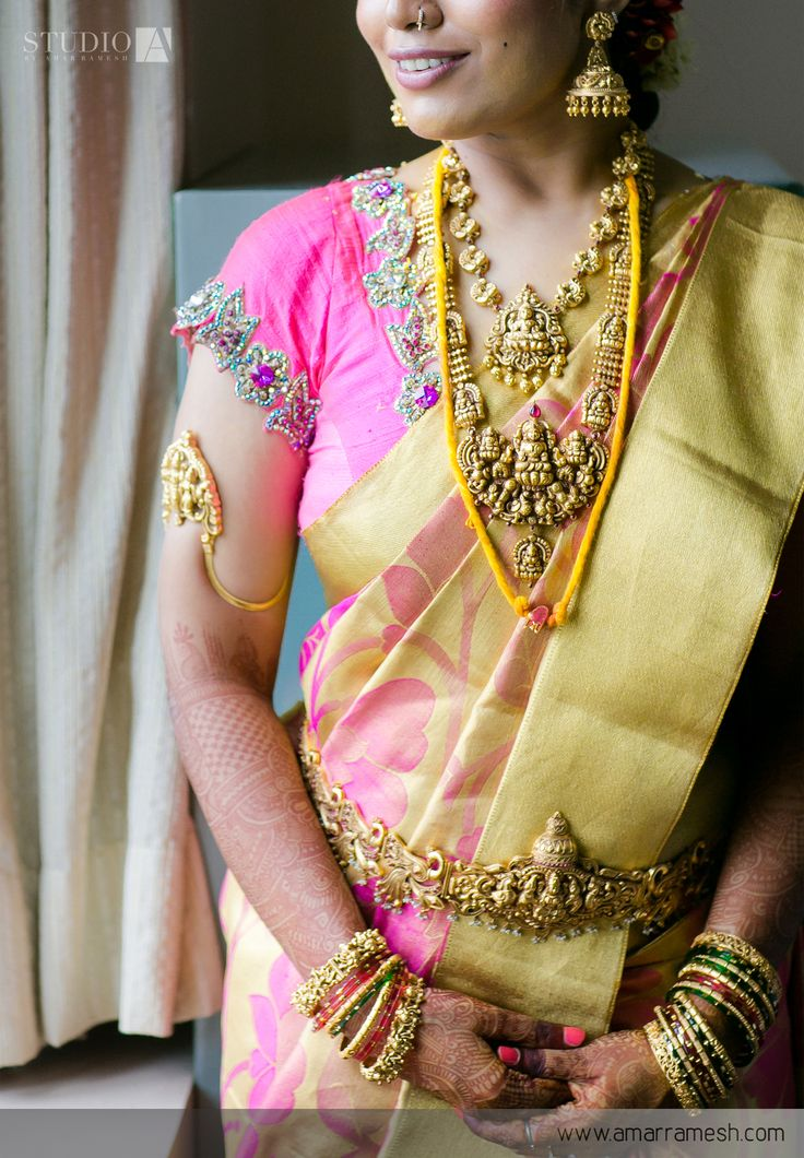 South Indian bride. Gold Indian bridal jewelry.Temple jewelry. Jhumkis.Pink and gold silk kanchipuram sari.Braid with fresh jasmine flowers. Tamil bride. Telugu bride. Kannada bride. Hindu bride. Malayalee bride.Kerala bride.South Indian wedding.