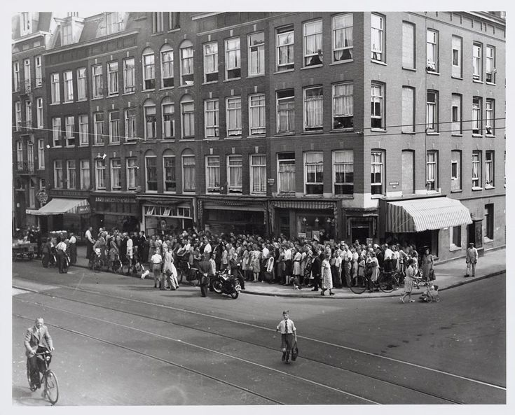 1947. In line for bread near a bakery in the Ferdinand Bolstraat. Food was still in short supply just 2 years after World War II ended. #amsterdam #1947 #FerdinandBolstraat.