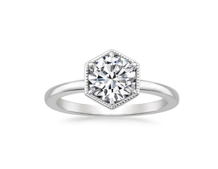 ''Sante'' Solitaire Engagement Diamond Ring This distinctive ring features a hexagonal setting with alluring milgrain embellishment.  Claw prongs embrace the center gem for a look both sophisticated and chic.