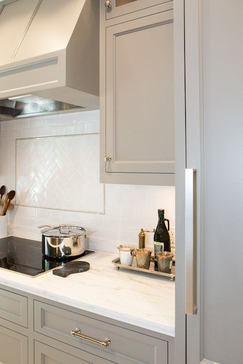 Cabinets painted with River Reflections from Benjamin Moore.