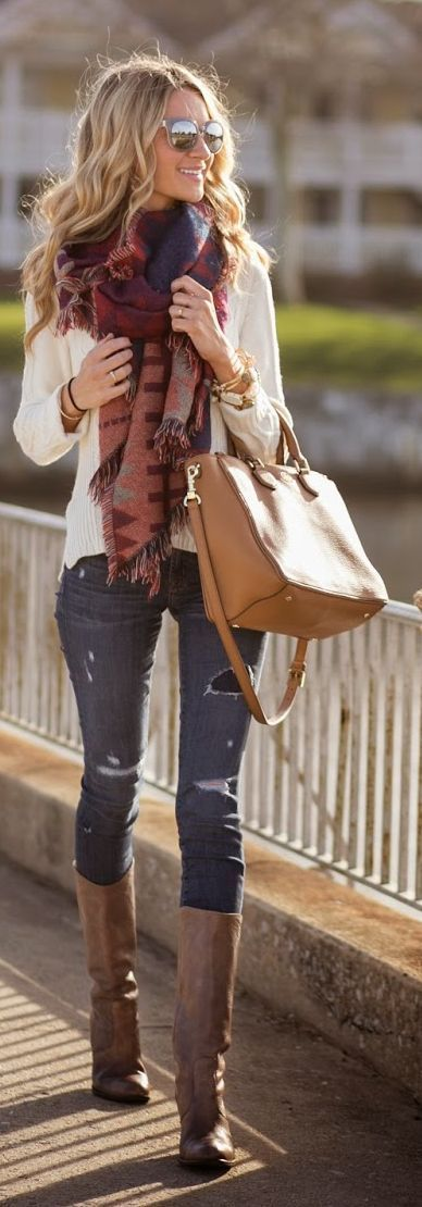 Ladder Fringe Scarf with Vented Cable-Knit Pullover and Toothpick jeans in destructed, Brown long leather booties.