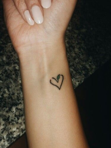 My first tattoo. It is a vegan heart. I love it so much