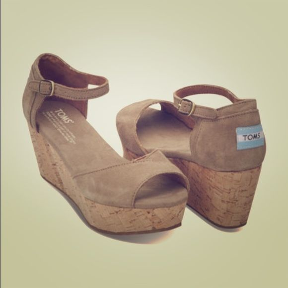 Neutral wedges These TOMS sandals are brand new! Never worn. Come in box. Cork wedge and Suede upper. TOMS Shoes Wedges