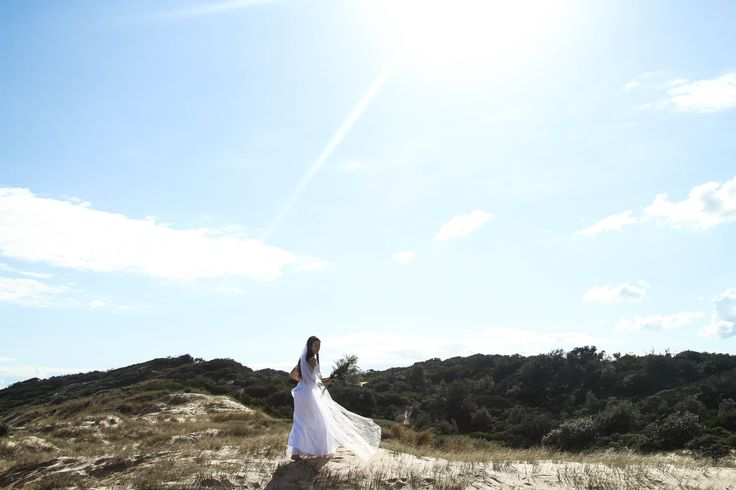 Potential Final #8 - One of my favourite shots, love the lighting - the way the brides dress is blowing in the wind gives it an ethereal feel