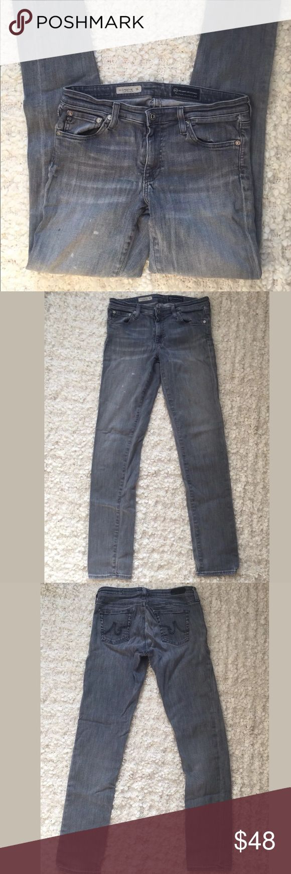"""AG  Adriano Goldschmied the legging super skinny Excellent used condition! AG """"the legging"""" jeans super skinny Size 29 regular. Have a couple of lighter and darker spots on the legs please see pictures.    The Legging by AG is a super skinny legion fit in gray. Pants feature a five pocket styling. Zip fly with one button closure. 98% cotton. Made in USA  Waist 15 inches  Inseam 30.5 inches  Rise 7.5 inches  B52 Ag Adriano Goldschmied Jeans Skinny"""
