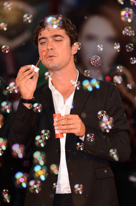 Actor Riccardo Scamarcio creates soap bubbles on the red carpet wearing a Jaeger-LeCoultre watch at the 'Tracks' premiere during the 70th Venice Film Festival at the Palazzo del Cinema on August 29, 2013 in Venice, Italy.