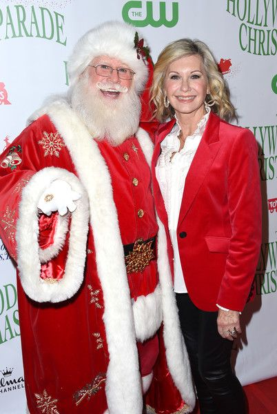 Olivia Newton-John Photos Photos - Olivia Newton John and Santa Claus attend the 85th annual Hollywood Christmas parade on Hollywood Boulevard in Hollywood, on November 27, 2016. / AFP / CHRIS DELMAS - 85th Annual Hollywood Christmas Parade - Arrivals