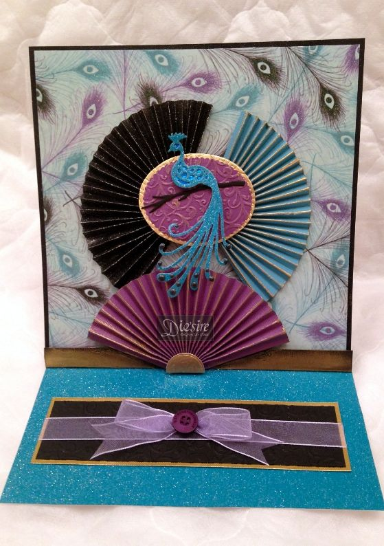 Angela O'Donoghue - Kimono luxury paper pad - Matt Black card - Spray and Sparkle - Kimono Peacock die - Matching coloured paper for fans - Pebeo Gilding wax - Collal 3D Glue Gel - Collall Tacky glue - Mauve ribbon - Purple button - Gold card - #crafterscompanion