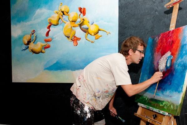 Contempory fine artist Svend Høgh doing action LIVE paint at an art show in Copenhagen, Denmark.  Photo © Niels Berg, 2012