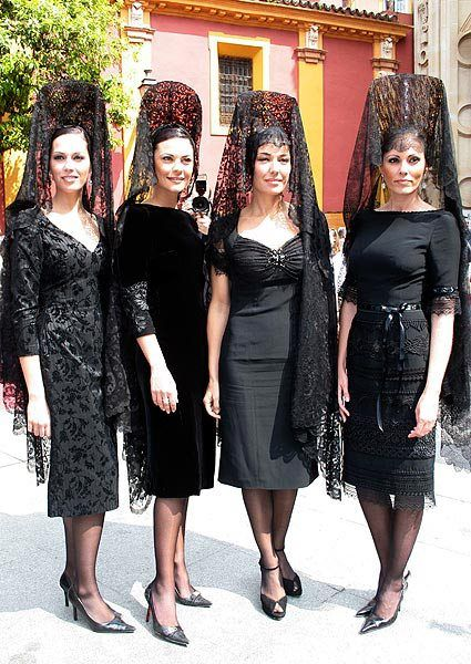 "Women with ""mantilla"" typical dress on Semana Santa in Seville, Spain"