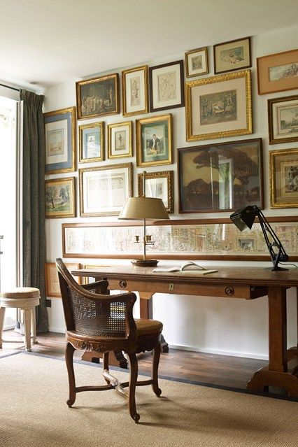 Study with Gilt-Framed Art - Decorating Ideas for Small Flats and Studio Apartments - office with wall covered in fine art, antique traditional wooden furniture.