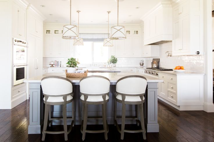 Creamy white cabinets and gray islands || chelsea gray island