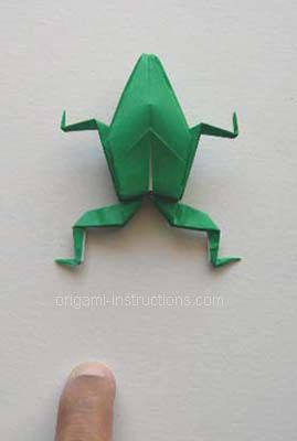 Origamil hopping frog--I remember these when I was a kid!  Never knew how to make them, though-- this is a good tutorial!