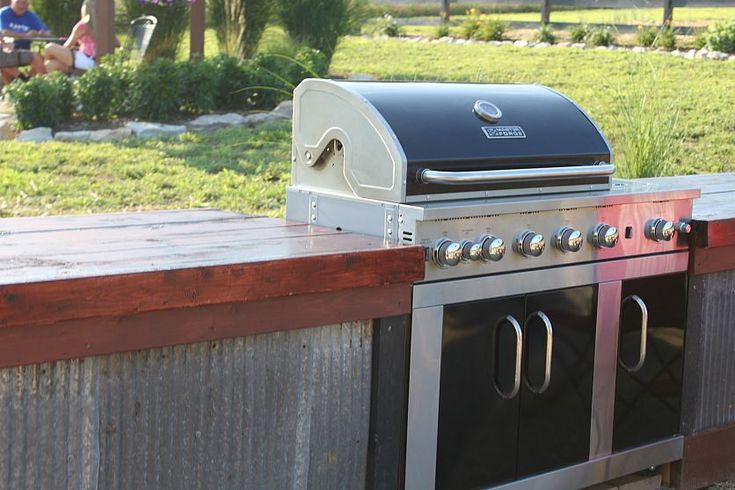 Outdoor kitchen created with metal clad siding... LOVE!