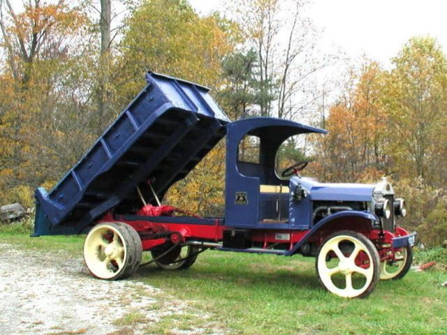 1928 Mack AB Dump Truck with Chain Drive and Solid Tires.