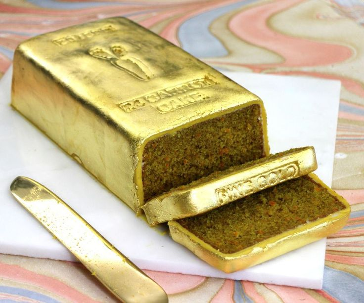 """Canadian designer Paige Russell (previously) whipped up a clever 24 """"carrot"""" cake--that is a carrot cake made with 24 baby carrots and shaped like a gold bar. The metallic gold look is achieved by ..."""