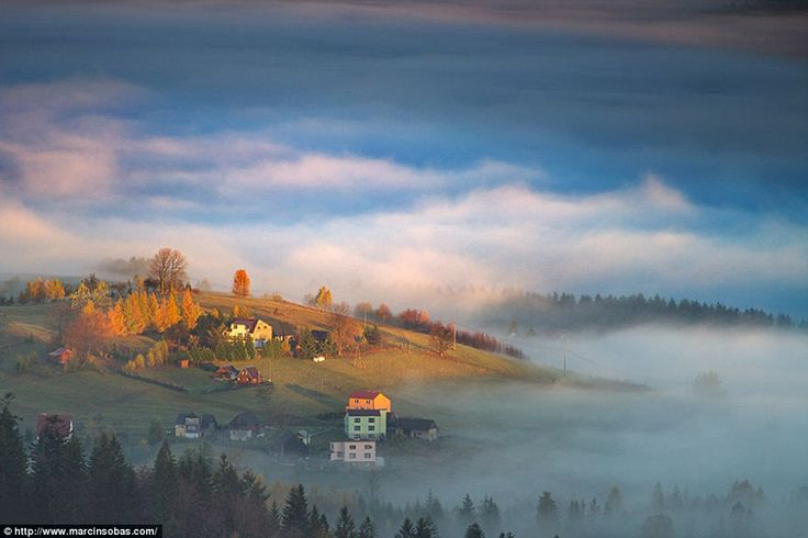 The first rays of sunlight turns the clouds pink and the land orange in Marcin Sobas's ima...