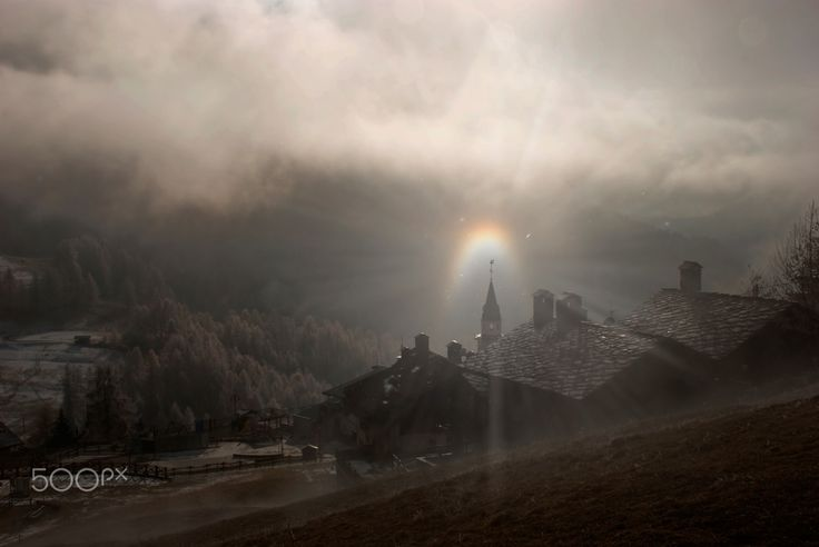 mystical atmosphere - mystical atmosphere, created by the snow that filtered sunlight creates a special rainbow that surrounds the church tower