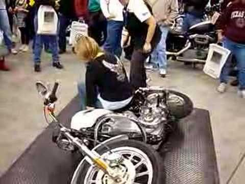 How to pick up a 700 lb. bike! They teach this at the Harley Davidson Garage Party for Women.