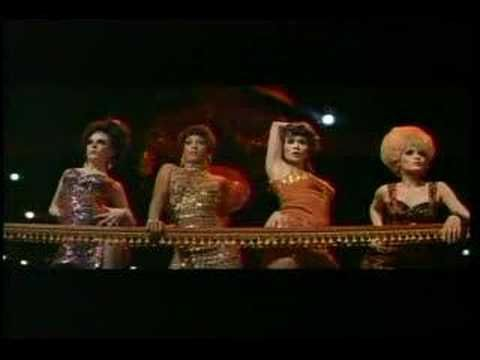 "Sweet Charity. "" Big Spender"". Directed and choreographed by Bob Fosse, written by Neil Simon, and with music by Cy Coleman and Dorothy Fields. It stars Shirley MacLaine and features John McMartin, Sammy Davis, Jr., Ricardo Montalban, Chita Rivera, Paula Kelly and Stubby Kaye. Based on Fellini's film Le Notti di Cabiria (Nights of Cabiria). Costumes by Edith Head"