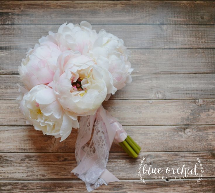 This silk peony bouquet features creamy white peonies with soft pink highlights. It is hand tied with blush satin and cream lace. by blueorchidcreations on Etsy