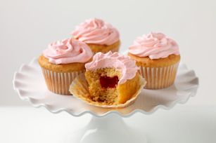 PB & J Cupcakes - Strawberry-flavored JELL-O stands in for jelly in these moist and creamy PB & J Cupcakes.
