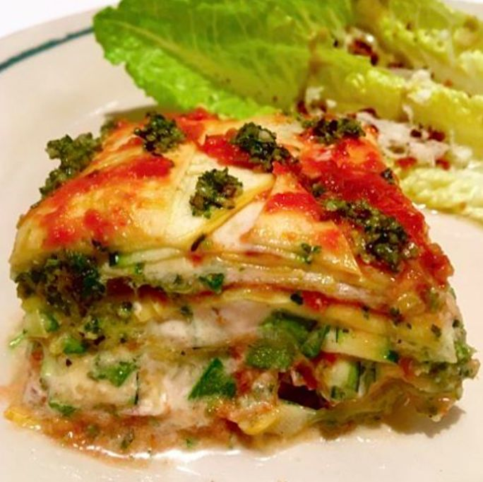 This Raw Lasagna is made this thinly sliced yellow summer squash and zucchini layered with sundried tomato sauce, pumpkin seed pesto and cashew béchamel