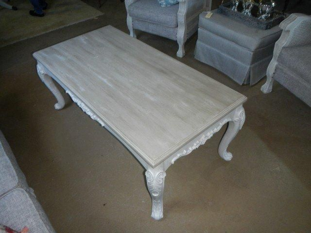 Legs dry brushed with original over French linen with a wood finished top
