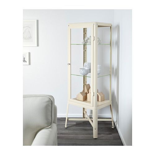 This looks like one of those old hospital / doctor's office cabinets.  FABRIKÖR Glass-door cabinet - beige - IKEA