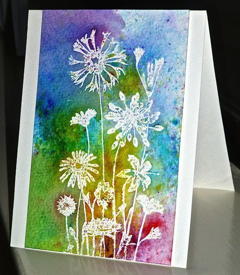 handmade card for TLC555 ... emboss resist technique ... field flowers embossed in white ...  Brushos watercolor powders for background ... dried between colors to prevent muddy color blend ...  beautiful ...