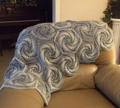 Hexagon patterned afghan with variegated yarn. So pretty. POsted at ...