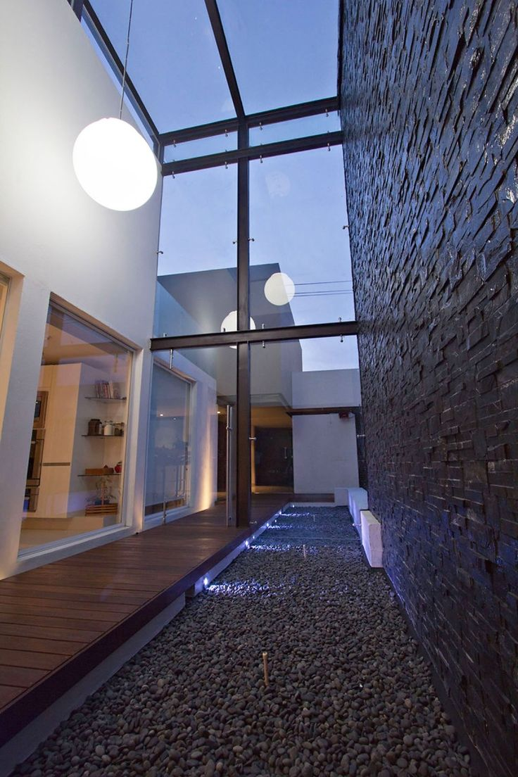 Magnificent House Renovation in Urban Area: Bright White Rounded Lamp From Iron Pergola With Glass Panel Above Pebble Pool In Refurbished Li...