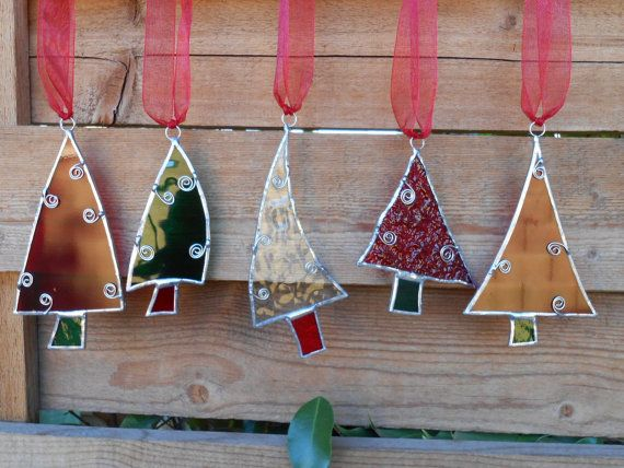 These 5 Stained Glass Christmas Tree Ornaments come as a package deal! As you can see there are 3 red, 1 green, 1 clear. They range in size from 5 1/4 to 3 1/2. Most are at least 4 L.  They all hang from red ribbon.  Perfect for your tree or someone you Love