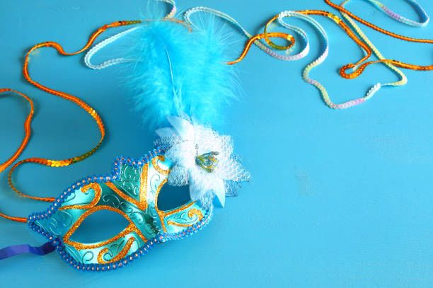 elegant venetian mask on blue wooden background stock photo