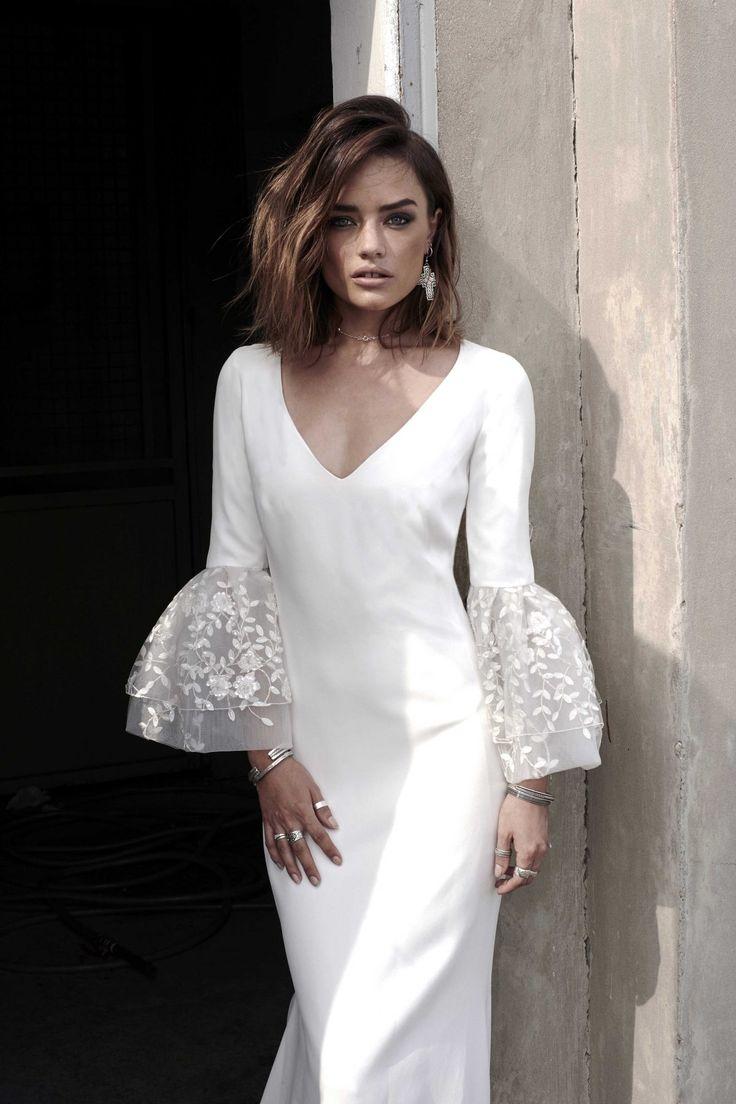 The unique sleeves on this wedding dress make it fabulous! 2018 Rime Arodaky. #weddingdress2018 #rimearadoky