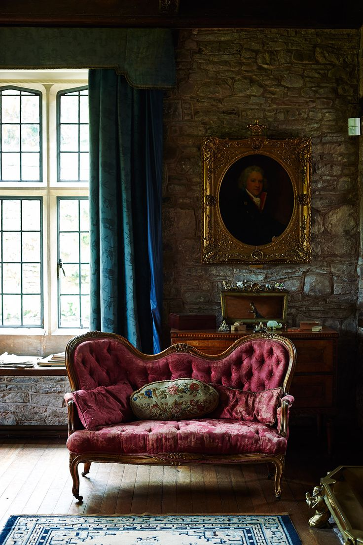 Old fashion living, great use of texture, velvet, brick, wood, gold