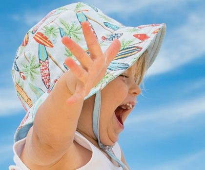 Boys Dozer Koby Bucket - Reversible. This gorgeous surf hat is made from soft 100% cotton. It is fully reversible, giving you 2 styles from one hat. One side is light blue with a surfboard print, while the other is light blue.