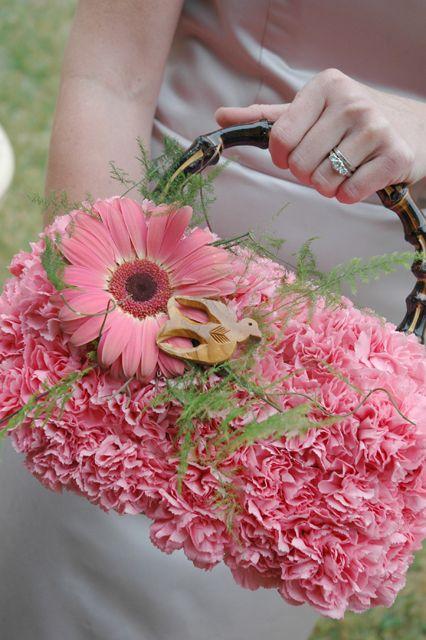 Wedding Ceremony Decoration (Source: branchingoutevents.com. A flower purse for the Bride or Bridesmaids, how unique!