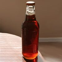 The Easiest Way To Open A Beer Bottle—Without An Opener - WomansDay.com