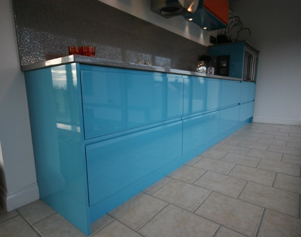 High Gloss Lacquered Blue Handleless Kitchen.  Made to measure in bespoke colour.
