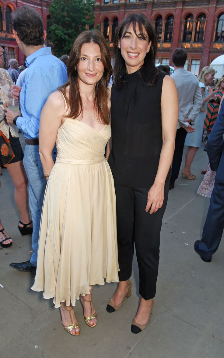 Maria Milano and Samantha Cameron, wearing a black Cefinn ensemble.