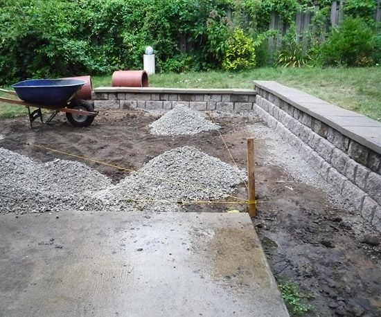 Once the work was done digging out space for the new patio, it was time to start filling it in. Three inches of crushed limestone was applied, then topped it with 1 inch of paver base (or sand).