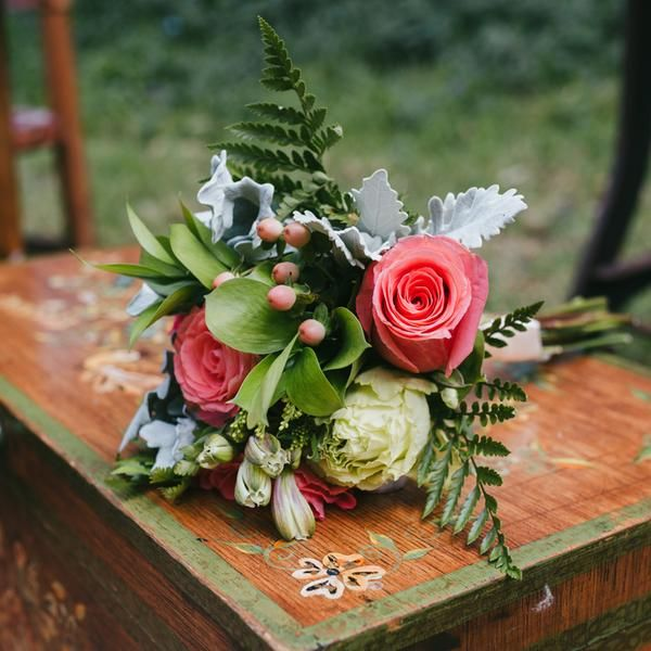 Make all your rustic dreams come true with this picturesque bridesmaids bouquet of green ferns and ruscus embracing pink and lime green roses.